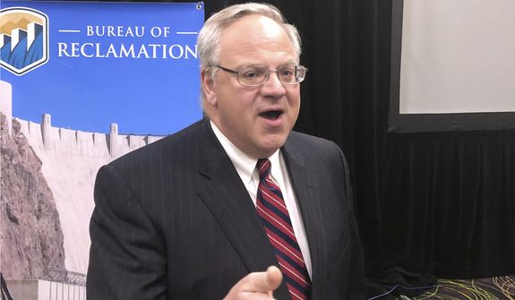 U.S. Interior Secretary David Bernhardt speaks to reporters Friday, Dec. 13, 2019, after addressing water managers from seven Western U.S. states at a Colorado River Water Users Association conference in Las Vegas. (AP Photo/Ken Ritter) ** FILE **