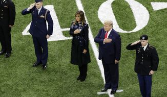 President Donald Trump, second from right, and first lady Melania Trump attend the NCAA College Football Playoff national championship game Monday, Jan. 13, 2020, in New Orleans. (AP Photo/Eric Gay)  **FILE**