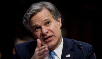 In this Nov. 5, 2019, file photo, FBI Director Christopher Wray testifies before a Senate Homeland Security Committee hearing on Capitol Hill in Washington. (AP Photo/Andrew Harnik, File) ** FILE **