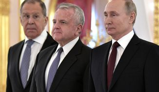 New U.S. Ambassador to Russia John Sullivan, center, poses after presenting his diplomatic credentials with Russian President Vladimir Putin, right, and Russian Foreign Minister Sergei Lavrov during a ceremony to receive credentials from newly appointed foreign ambassadors to Russia in Kremlin, in Moscow, Russia, Wednesday, Feb. 5, 2020. (Aleksey Nikolskyi, Sputnik, Kremlin Pool Photo via AP)