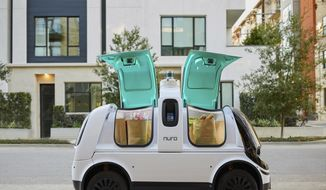 "This undated image provided by Nuro in February 2020 shows their self-driving vehicle ""R2"" carrying bags of groceries. On Thursday, Feb. 6, 2020, the U.S. National Highway Traffic Safety Administration granted temporary approval for Silicon Valley robotics company Nuro to the a low-speed autonomous delivery vehicle, without side and rear-view mirrors and other safety provisions required of vehicles driven by humans. (Nuro via AP)"