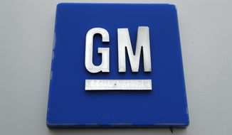 This Jan. 27, 2020, file photo shows a General Motors logo at the General Motors Detroit-Hamtramck Assembly plant in Hamtramck, Mich. GM is pulling out of Australia, New Zealand and Thailand as part of a strategy to exit markets that don't produce adequate returns on investments, the company said in a statement Sunday, Feb. 17. (AP Photo/Paul Sancya, File)