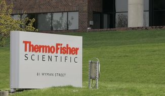 This April 26, 2007, file photo, shows the exterior of Thermo Fisher Scientific Inc., of Waltham, Mass.  Thermo Fisher Scientific Inc., a maker of scientific instrument and laboratory supplies, is buying Qiagen in a deal valued at about $10.1 billion, reported Tuesday, March 3, 2020. Qiagen NV is a provider of molecular diagnostics and sample preparation technologies. The Netherlands-based company has approximately 5,100 workers at 35 locations in more than 25 countries.  The deal is expected to close in the first half of 2021.  (AP Photo/Stephan Savoia, File)