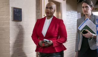 Rep. Ayanna Pressley, D-Mass., and other House Democrats arrive to meet with Speaker of the House Nancy Pelosi, D-Calif., who is moving swiftly toward House passage of a coronavirus aid package possibly this week, on Capitol Hill in Washington, Wednesday, March 11, 2020. (AP Photo/J. Scott Applewhite)