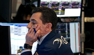 Trader Peter Mazza works on the floor of the New York Stock Exchange Monday, March 16, 2020. (AP Photo/Craig Ruttle)