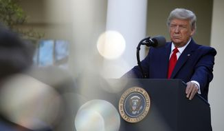 President Donald Trump listens to a question from a reporter as he speaks about the coronavirus in the Rose Garden of the White House, Monday, March 30, 2020, in Washington. (AP Photo/Alex Brandon)