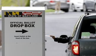 A motorist drops off a mail-in ballot outside of a voting center during the 7th Congressional District special election, Tuesday, April 28, 2020, in Windsor Mill, Md. The state election board says that voters will be able to drop their general-election ballots at hundreds of drop boxes instead of mailing them or casting them in person. 
