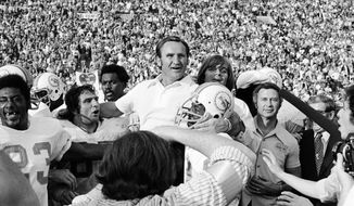 FILE - In this Jan. 14, 1973, file photo, Miami Dolphins coach Don Shula is carried off the field after his team won  the NFL football Super Bowl game 14-7 against the Washington Redskins in Los Angeles. Shula, who won the most games of any NFL coach and led the Miami Dolphins to the only perfect season in league history, died Monday, May 4, 2020, at his home in Indian Creek, Fla., the team said. He was 90.  (AP Photo/File)