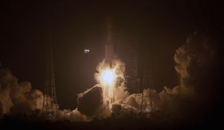 In this photo released by Xinhua News Agency, a Long March 7 rocket carrying the Tianzhou 1 cargo spacecraft blasts off from the Wenchang Space Launch Center in Wenchang in southern China's Hainan Province, Thursday, April 20, 2017. China has launched its first unmanned cargo spacecraft Thursday on a mission to dock with the country's space station. (Ju Zhenhua/Xinhua via AP)