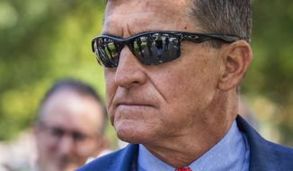 In this Sept. 10, 2019, file photo Michael Flynn, President Donald Trump's former national security adviser, leaves the federal court following a status conference with Judge Emmet Sullivan, in Washington. (AP Photo/Manuel Balce Ceneta, File) **FILE**