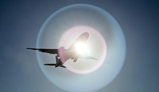 In this March 18, 2020 file photo, a Southern China Airlines flight from Guangzhou, China, passes in front of the sun as it arrives at Vancouver International Airport in Richmond, British Columbia, Canada. On Wednesday, June 3, 2020, the Trump administration moved to block Chinese airlines from flying to the U.S. in an escalation of trade and travel tensions between the two countries. (Jonathan Hayward/The Canadian Press via AP)