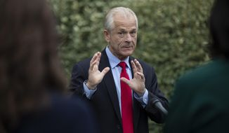 White House trade adviser Peter Navarro speaks with reporters at the White House, Thursday, June 18, 2020, in Washington. (AP Photo/Alex Brandon)