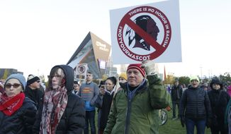 FILE - In this Oct. 24, 2019, file photo, Native American leaders protest against the Redskins team name outside U.S. Bank Stadium before an NFL football game between the Minnesota Vikings and the Washington Redskins in Minneapolis. Several Native American leaders and organizations have sent a letter to NFL Commissioner Roger Goodell calling for the league to force Washington Redskins owner Dan Snyder to change the team name immediately.  (AP Photo/Bruce Kluckhohn) ** FILE **