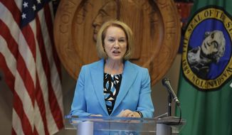 Seattle Mayor Jenny Durkan speaks Monday, July 13, 2020, during a news conference at City Hall in Seattle. Durkan and Police Chief Carmen Best were critical of a plan backed by several city council members that seeks to cut the police department's budget by 50 percent. (AP Photo/Ted S. Warren)