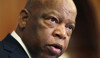 This June 16, 2010, file photo, Rep. John Lewis, D-Ga., participates in a ceremony to unveil two plaques recognizing the contributions of enslaved African Americans in the construction of the United States Capitol on Capitol Hill in Washington. Lewis, who carried the struggle against racial discrimination from Southern battlegrounds of the 1960s to the halls of Congress, has died. House Speaker Nancy Pelosi confirmed his passing late Friday, July 17, 2020. (AP Photo/Carolyn Kaster, File)
