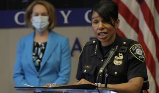 In this file photo, Seattle Police Chief Carmen Best, right, speaks, Monday, July 13, 2020, during a news conference at City Hall in Seattle.  (AP Photo/Ted S. Warren)  ** FILE **