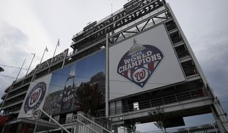 A 2019 World Series champions sign is displayed at Nationals Park, Wednesday, July 22, 2020 in Washington. (AP Photo/Nick Wass)