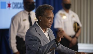 Mayor Lori Lightfoot speaks during a press conference at City Hall, in Chicago, Wednesday morning, July 22, 2020. Authorities say gunfire outside the funeral home on Chicago's South Side that wounded multiple people was part of an ongoing conflict involving the gang of the man being mourned. (Pat Nabong/Chicago Sun-Times via AP)