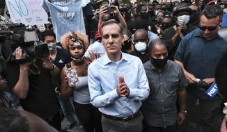 Los Angeles Mayor Eric Garcetti talks to Black Lives Matter protesters in downtown Los Angeles, June 2, 2020. (AP Photo/Richard Vogel) ** FILE **