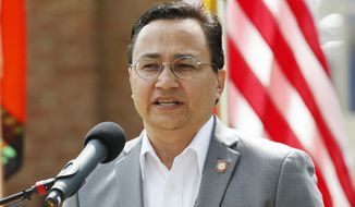 FILE - Cherokee Nation Principal Chief Chuck Hoskin Jr., speaks during a news conference in Tahlequah, Okla. in this Aug. 22, 2019 file photo. A federal judge has ruled that Oklahoma's tribal gaming compacts automatically renewed on Jan. 1, 2020, handing a victory to the tribes who sued Gov. Kevin Stitt to renew them. (AP Photo/Sue Ogrocki, File)