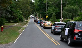 "In this photo provided by the Connecticut Teachers Association, a ""School Safety First"" car caravan approaches the governor's mansion in Hartford Conn., Thursday, July 30, 2020. About two dozen groups of teachers, parents, and advocates held coordinated demonstrations on Thursday, demanding more funding to ensure schools can reopen safely during the continuing pandemic. ( Alan Grant, Digital Creations, on behalf of Connecticut Education Association via AP)"