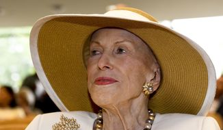 FILE- In this Aug. 3, 2018 file photo, Saratoga Springs philanthropist and thoroughbred racing owner Marylou Whitney is seen at the National Museum of Racing and Hall of Fame in Saratoga Springs, N.Y. Whitney's widower, John Hendrickson, told the Wall Street Journal he plans to sell the 36,000-acre tract of lakes and forest in the Adirondacks known as Whitney Park for $180 million. Environmental groups have urged the state to acquire the land and add it to the permanently protected Forest Preserve.  (AP Photo/Hans Pennink, File)