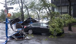 Damage is seen Tuesday, Aug. 4, 2020 in lower Manhattan as Tropical Storm Isaias moved past New York, producing strong winds that at times caused damage. Barriers that were in front of a building that were meant to block flood waters were picked up and tossed about. (AP Photo/Craig Ruttle)