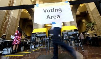 In this March 3, 2020, file photo, voters cast their ballots on Super Tuesday, at a voting center at Union Station in downtown Los Angeles. (AP Photo/Ringo H.W. Chiu, File)