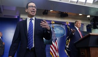 President Donald Trump listens as Treasury Secretary Steven Mnuchin speaks at a news conference in the James Brady Press Briefing Room at the White House, Monday, Aug. 10, 2020, in Washington. (AP Photo/Andrew Harnik) **FILE**