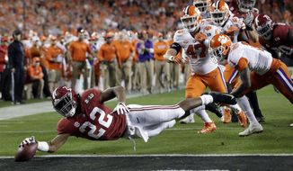 FILE - In this Jan. 7, 2019, file photo, Alabama's Najee Harris reaches for the end zone during the first half the NCAA college football playoff championship game against Clemson, in Santa Clara, Calif. After the Power Five conference commissioners met Sunday, Aug. 9, 2020, to discuss mounting concern about whether a college football season can be played in a pandemic, players took to social media to urge leaders to let them play.(AP Photo/David J. Phillip, File)  **FILE**