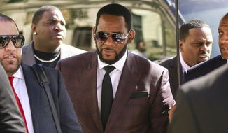 In this June 26, 2019, file photo, R&B singer R. Kelly, center, arrives at the Leighton Criminal Court building for an arraignment on sex-related felonies in Chicago. Federal prosecutors announced charges Wednesday, Aug. 12, 2020, against three men accused of threatening and intimidating women who have accused Kelly of abuse, including one man suspected of setting fire to a vehicle in Florida. (AP Photo/Amr Alfiky, File)