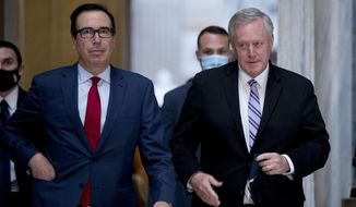 Treasury Secretary Steven Mnuchin, left, and White House Chief of Staff Mark Meadows, right, walk out of a meeting with House Speaker Nancy Pelosi of Calif. and Senate Minority Leader Sen. Chuck Schumer of N.Y. as they continue to negotiate a coronavirus relief package on Capitol Hill in Washington, Friday, Aug. 7, 2020. (AP Photo/Andrew Harnik) ** FILE **