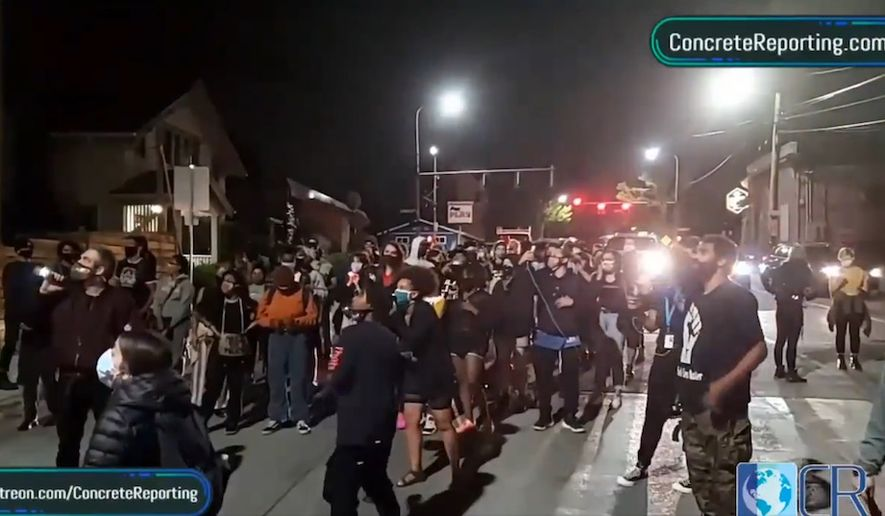 Black Lives Matter activists in Seattle demand homeowners give up their property as a form of reparations, Aug. 12, 2020. The march through neighborhoods was live-streamed by Concrete Reporting via the Periscope app. (Image: Periscope app live stream, Concrete Reporting, video screenshot)