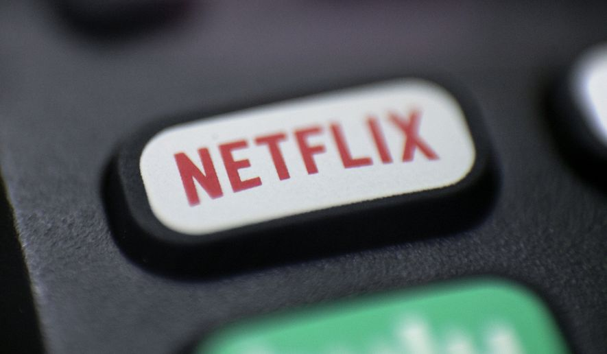 This Aug. 13, 2020, photo shows a logo for Netflix on a remote control in Portland, Ore. (AP Photo/Jenny Kane)
