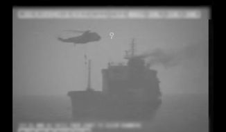 In this image made from video released by the U.S. military's Central Command, Iranian commandos fast-rope down from a helicopter onto the MV Wila oil tanker in the Gulf of Oman off the coast of the United Arab Emirates on Wednesday, Aug. 12, 2020. The Iranian navy boarded and briefly seized the Liberian-flagged oil tanker near the strategic Strait of Hormuz amid heightened tensions between Tehran and the U.S., a U.S. military official said Thursday, Aug. 13, 2020. (U.S. military's Central Command via AP)
