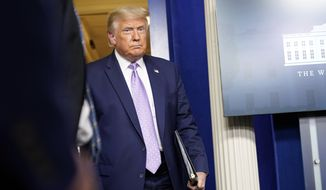 President Donald Trump arrives to speak at a news conference in the James Brady Press Briefing Room at the White House, Thursday, Aug. 13, 2020, in Washington. (AP Photo/Andrew Harnik)