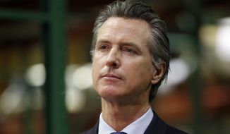 FILE - In this June 6, 2020, file photo, California Gov. Gavin Newsom listens to a reporter's question during a news conference in Rancho Cordova, Calif. The possible ascendancy of U.S. Sen. Kamala Harris to the vice presidency next year has kicked off widespread speculation in California about who might replace her if Democrats seize the White House.  At the center of the intrigue is Newsom, the person who would get to fill the vacancy if Joe Biden and Harris defeat President Donald Trump. (AP Photo/Rich Pedroncelli, Pool, File)