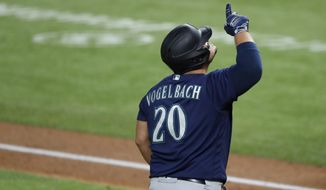 Seattle Mariners' Daniel Vogelbach (20) celebrates his two-run home run as he approaches home plate in the second inning of a baseball game against the Texas Rangers in Arlington, Texas, Wednesday, Aug. 12, 2020. The shot scored Shed Long Jr. (AP Photo/Tony Gutierrez)