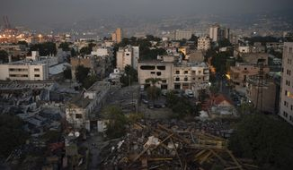 Damaged buildings are seen near the site of last week's massive explosion in the port of Beirut, Lebanon, Friday, Aug. 14, 2020. (AP Photo/Felipe Dana)