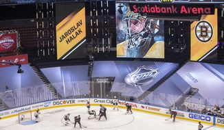 A picture of Boston Bruins goaltender Jaroslav Halak is displayed on a screen during the first period of a NHL first round Stanley Cup playoff game between the Carolina Hurricanes and Boston Bruins in Toronto, on Saturday, Aug. 15, 2020. (Chris Young/The Canadian Press via AP)