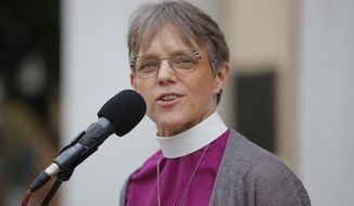 Bishop Mariann Edgar Budde of the Episcopal Diocese of Washington speaks during a service outside St. John's Episcopal Church in Washington, in a Friday, June 19, 2020, file photo. The Democratic Party is tapping a diverse group of faith leaders to speak at its presidential nominating convention this week. Among those speakers is Bishop Mariann Budde of the Episcopal Diocese of Washington, who will deliver the benediction on Tuesday, the second night of the Democratic convention. (AP Photo/Carolyn Kaster, File)