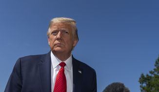 President Donald Trump listens to a question while speaking with reporters as he walks to Marine One on the South Lawn of the White House, Monday, Aug. 17, 2020, in Washington. Trump is en route to Minnesota and Wisconsin. (AP Photo/Alex Brandon)
