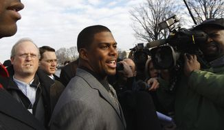 In this Jan. 19, 2011, file photo, Arizona Cardinals running back Jason Wright, center, talks to the media on Capitol Hill in Washington. The Washington Football Team has hired Jason Wright as team president. Hes the first Black person to hold this job in NFL history and at 38 becomes the youngest team president in the league. (AP Photo/Alex Brandon, File)  **FILE*