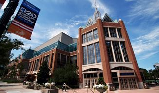 This Aug. 13, 2020, photo shows the Wisconsin Center, the location of a scaled-down Democratic National Convention. About 50,000 visitors were expected to inject about $250 million into the economy of the key presidential battleground state. But now, thanks to the ongoing coronavirus pandemic, the convention is nearly entirely online, with all of the major speakers, including presumptive nominee Joe Biden, skipping the trip to Milwaukee. It would have been the first time Milwaukee, a city of 1.6 million, hosted a presidential nominating convention. (AP Photo/Carrie Antlfinger)