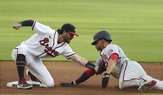 Atlanta Braves shortstop Dansby Swanson tags out Washington Nationals' Juan Soto on a steal-attempt at second base during the first inning of a baseball game Monday, Aug. 17, 2020, in Atlanta. (Curtis Compton/Atlanta Journal-Constitution via AP)