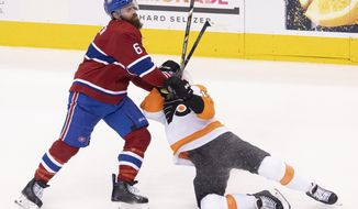 Montreal Canadiens defenceman Shea Weber (6) takes down Philadelphia Flyers defenceman Matt Niskanen (15) during the second period of an NHL Eastern Conference Stanley Cup first-round playoff game in Toronto, Ontario, Tuesday, Aug. 18, 2020. (Frank Gunn/The Canadian Press via AP)