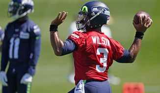 Seattle Seahawks quarterback Russell Wilson passes during NFL football training camp, Friday, Aug. 14, 2020, in Renton, Wash. (AP Photo/Ted S. Warren, Pool)