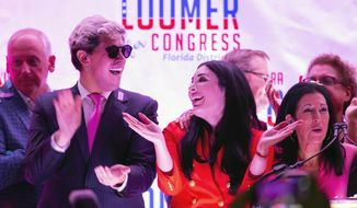 Republican congressional candidate Laura Loomer celebrates with Milo Yiannopoulos, left, and campaign director Karen Giorno, right, at an election night event at the airport Hilton in West Palm Beach, Fla., Tuesday, Aug. 18, 2020. Loomer, a far-right Republican candidate banned from social media sites because of her racist and anti-Muslim speech, won a congressional primary in Florida while embracing her role as a general election underdog in a heavily Democratic district that President Donald Trump calls home. (Allen Eyestone/The Palm Beach Post via AP)