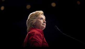FILE - In this July 30, 2016 file photo, then-Democratic presidential candidate Hillary Clinton pauses while speaking at a rally in Pittsburgh. (AP Photo/Andrew Harnik, File)