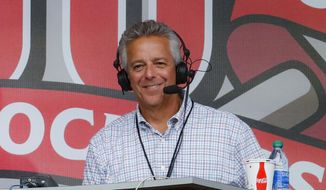 In this Sept. 25, 2019, file photo, Cincinnati Reds broadcaster Thom Brennaman sits in a special outside booth before the Reds' baseball game against the Milwaukee Brewers in Cincinnati. Brennaman used a gay slur during the broadcast of Cincinnati's game against the Kansas City Royals on Wednesday, Aug. 19, 2020. Brennaman used the slur moments after the Fox Sports Ohio broadcast returned from a commercial break before the seventh inning in the first game of a doubleheader. Brennaman did not seem to realize he was already on air. (AP Photo/John Minchillo, File)  **FILE**